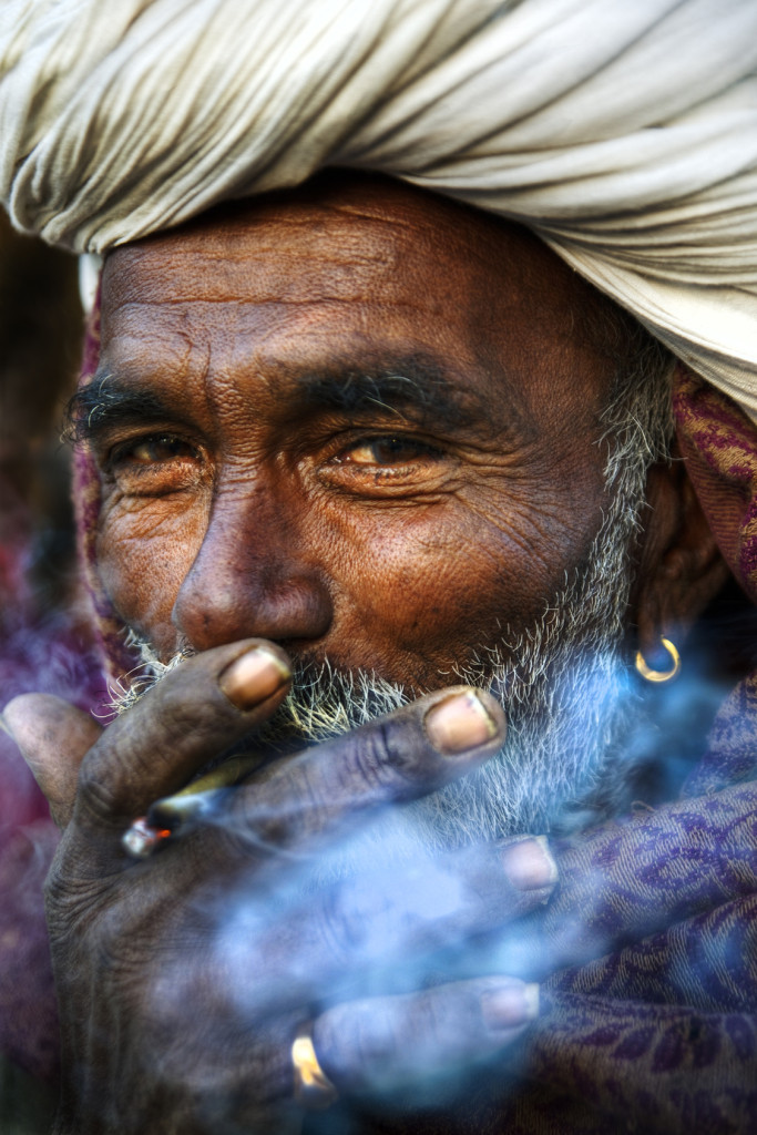 Indigenous Indian Man Smoking Happiness Concept